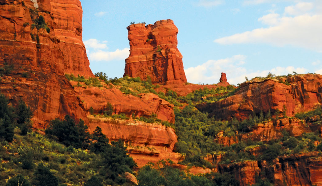 landscape image of Boynton Canyon against blue sky by Deb Weinkauff