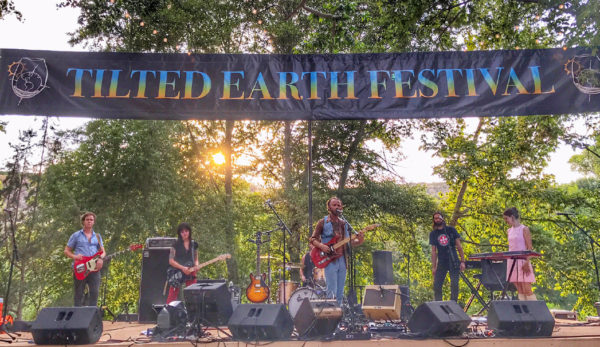 Musicians on stage at the Tilted Earth Music Festival